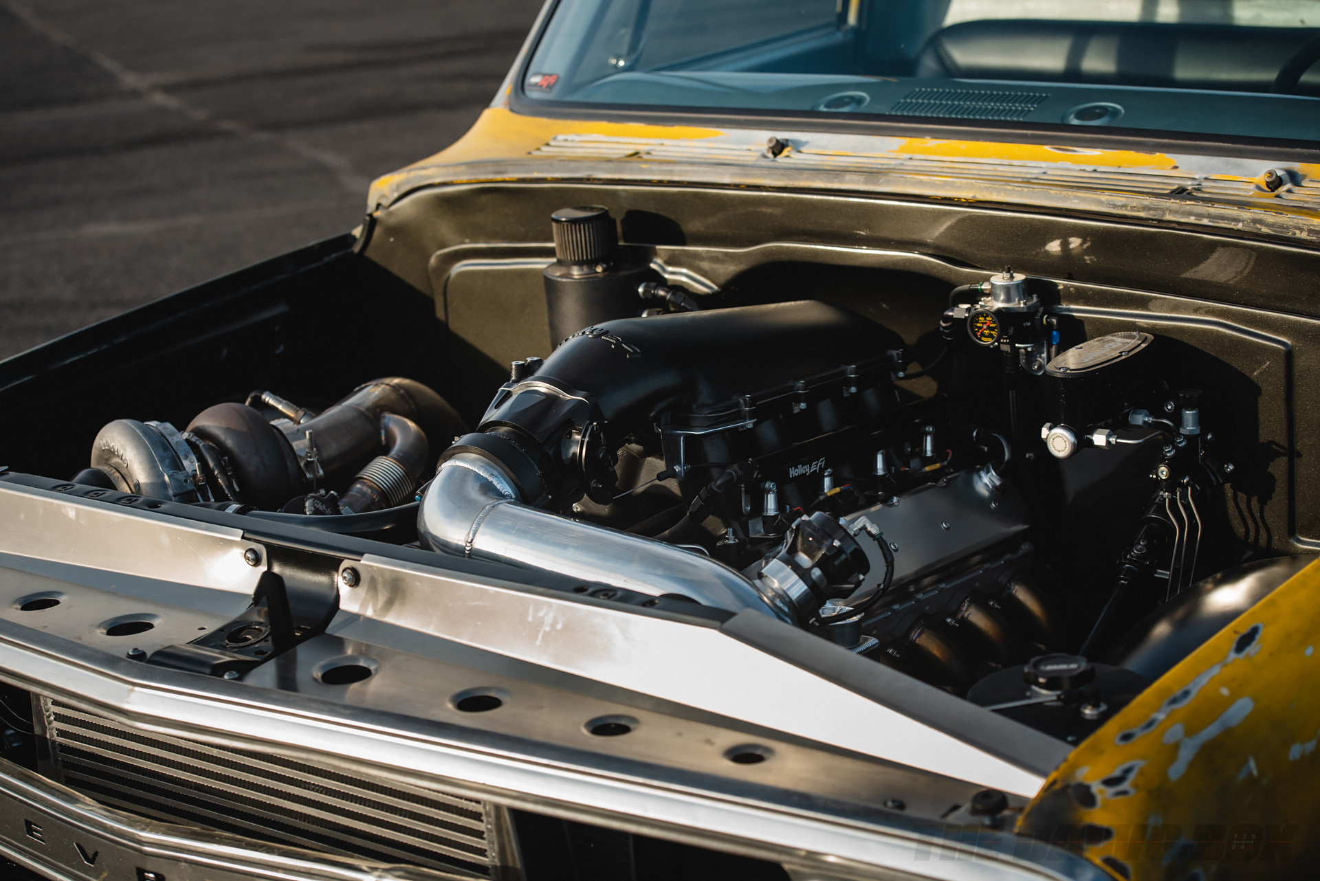 Close up of yellow Chevrolet C10 with and LS V8