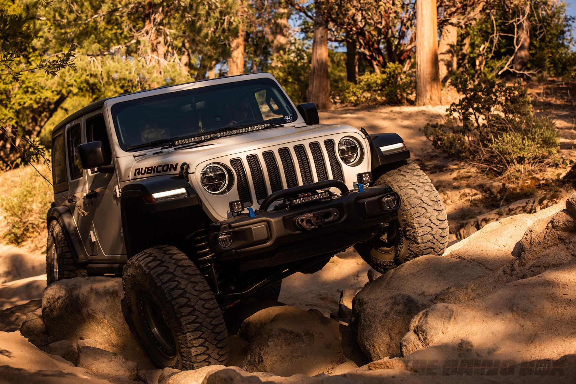 White Jeep Wrangler Rubicon rock crawling