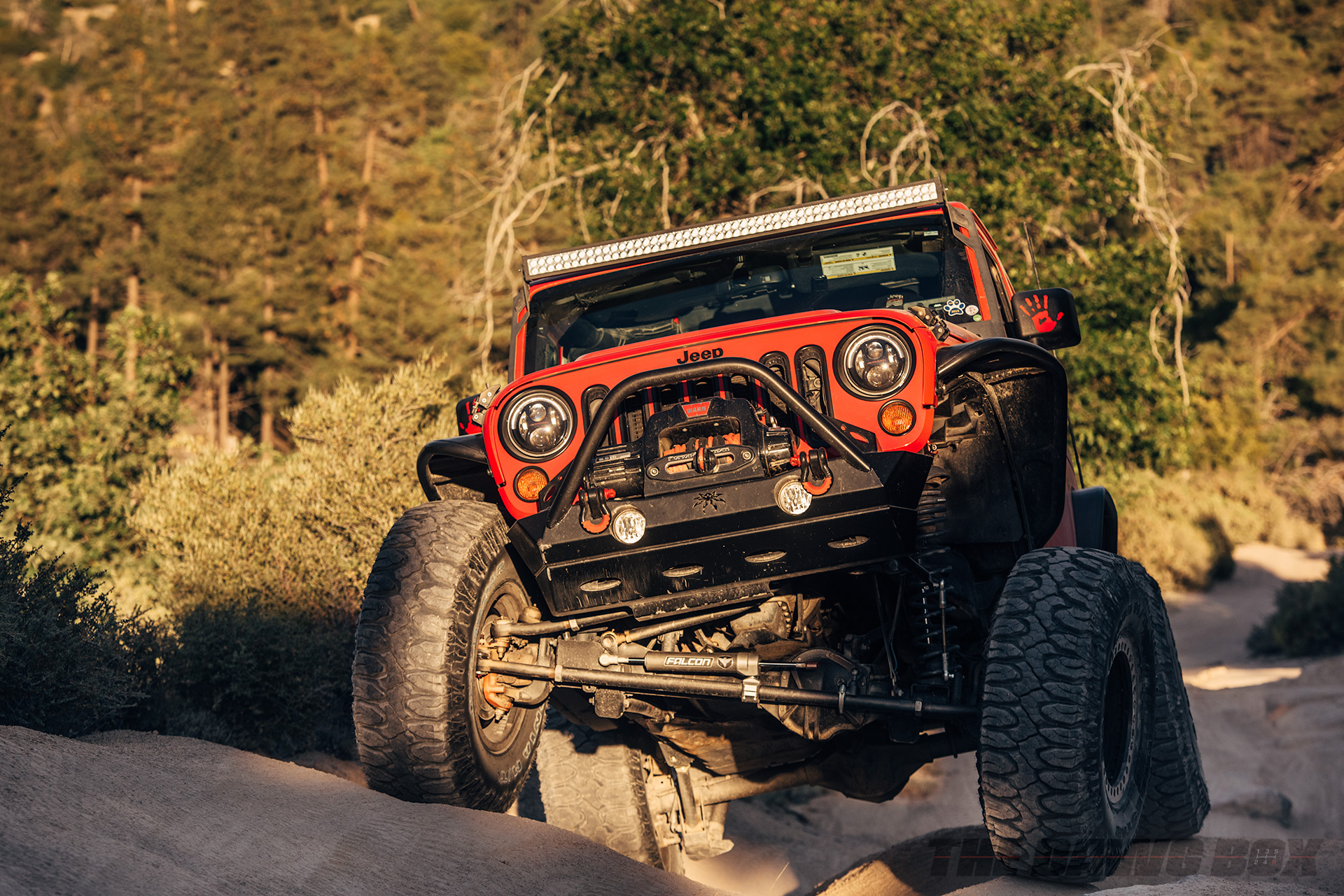 Shot of the Falcon suspension system on a Red-Orange Jeep Wrangler Moab