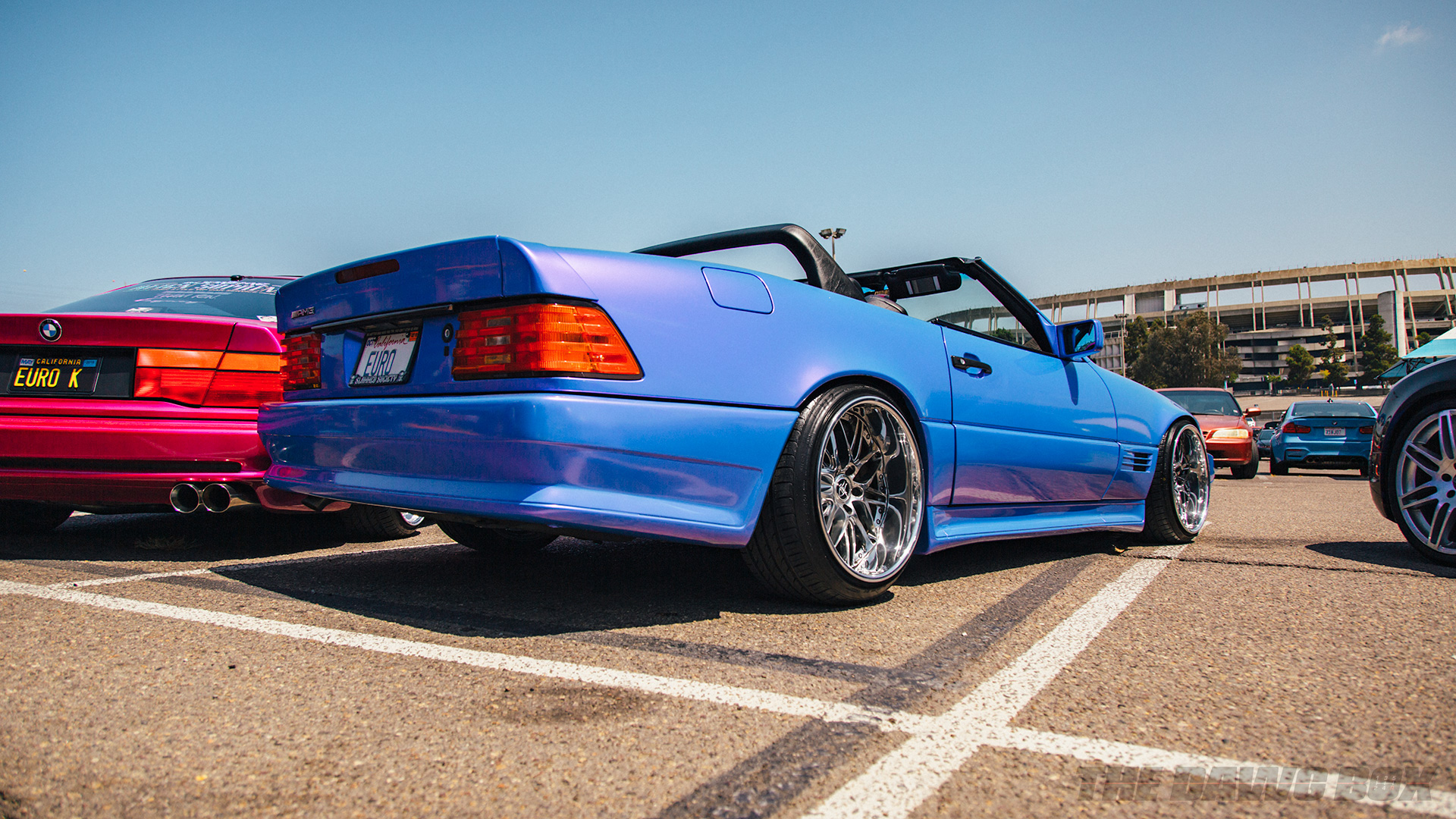 Blue convertible Merceds AMG and Pint BMW at Big Socal Euro