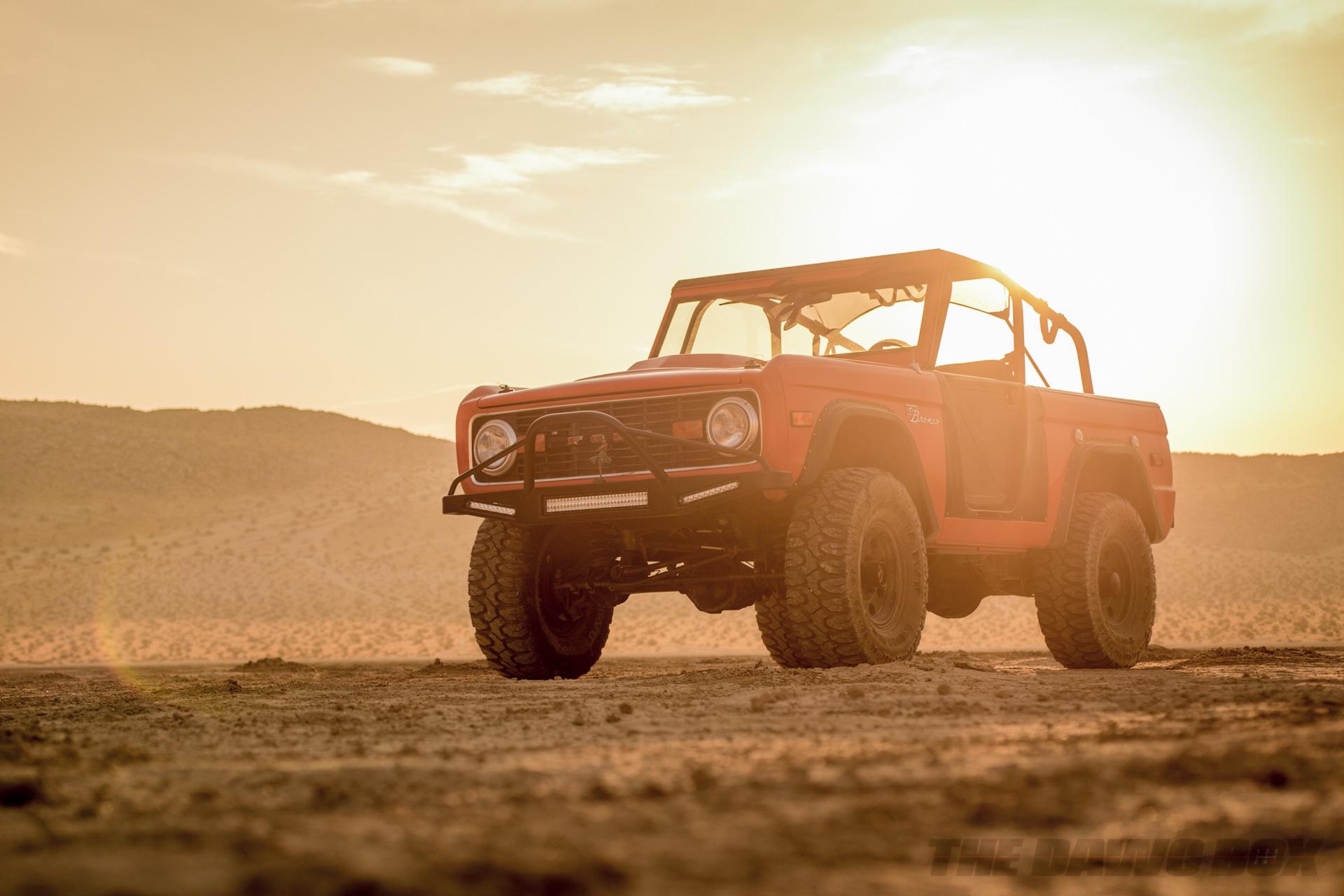 Orange Vintage 1971 Ford Bronco Sport on Milestar Patagonia MT in sunset desert