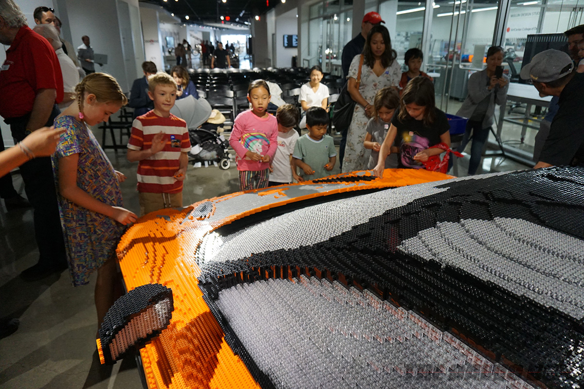 Kids with the Lego McLaren 720S