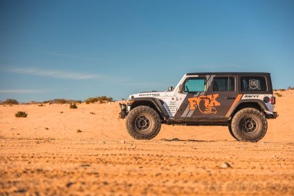 Side view of modified Jeep JL Wrangler in the desert
