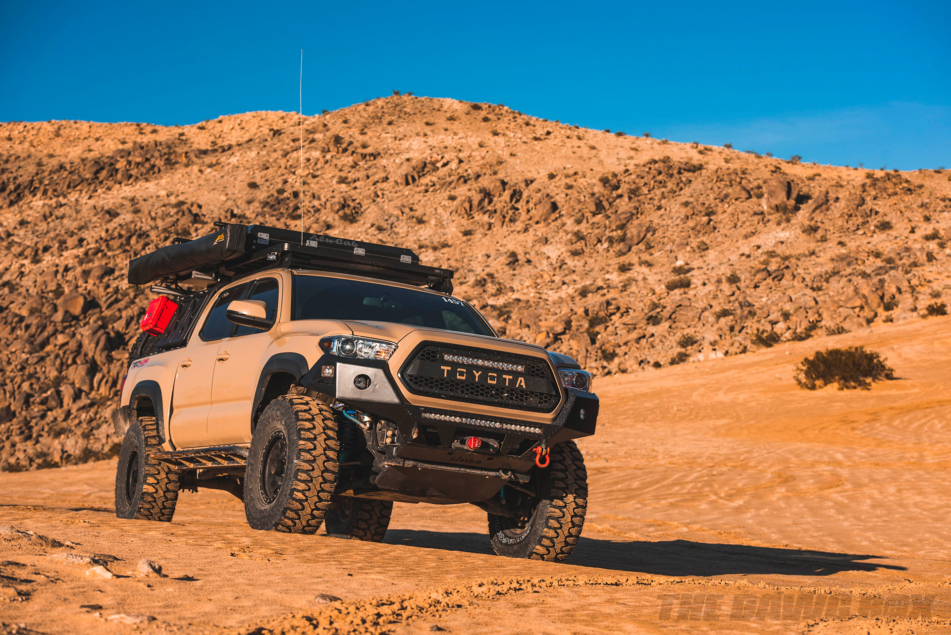 Toyota Tacoma with 35 inch Milestar Patagonia MT tires driving through a sandy desert