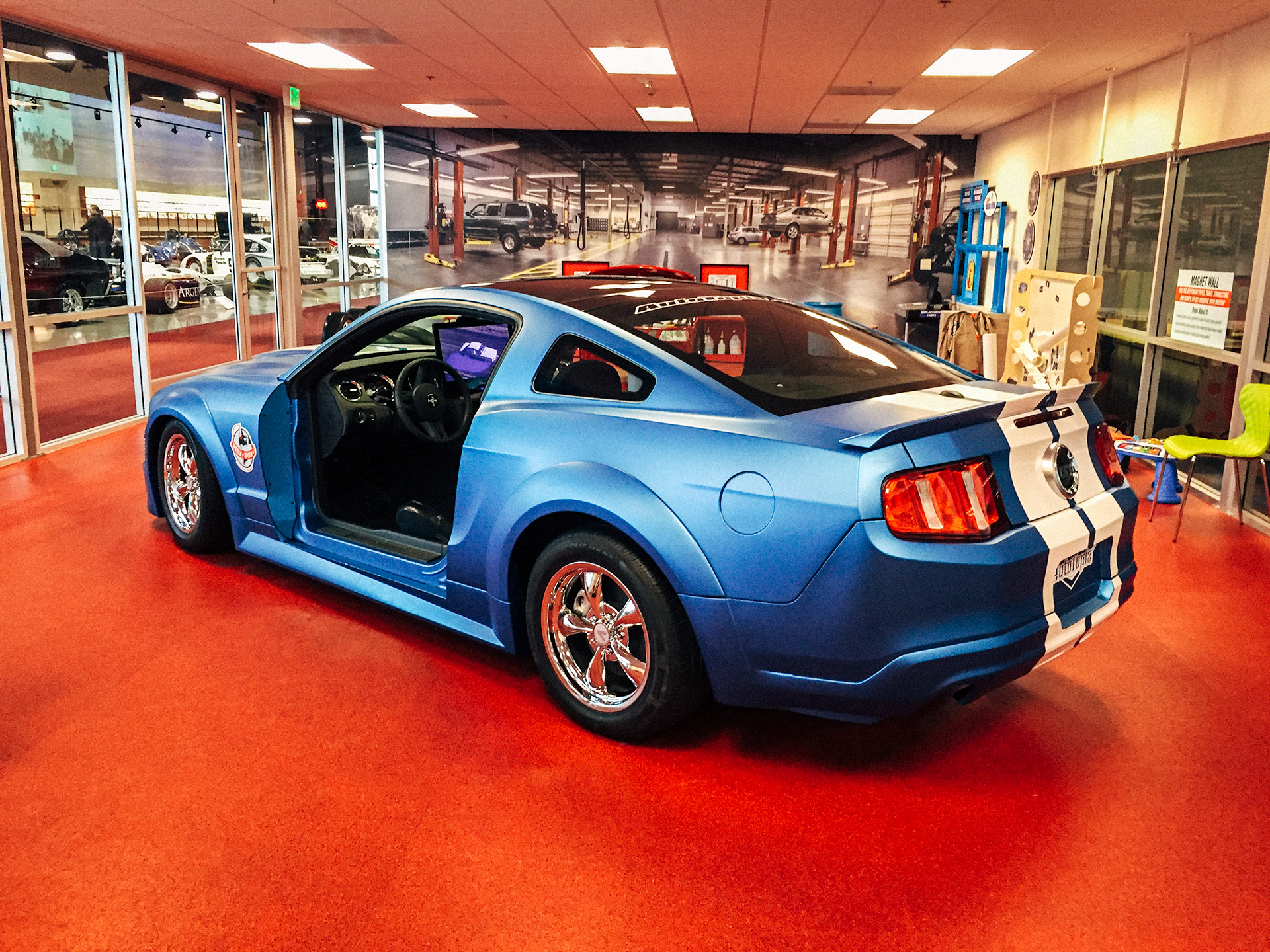 Blue ford mustang interactive exhibt at the World of Speed Museum