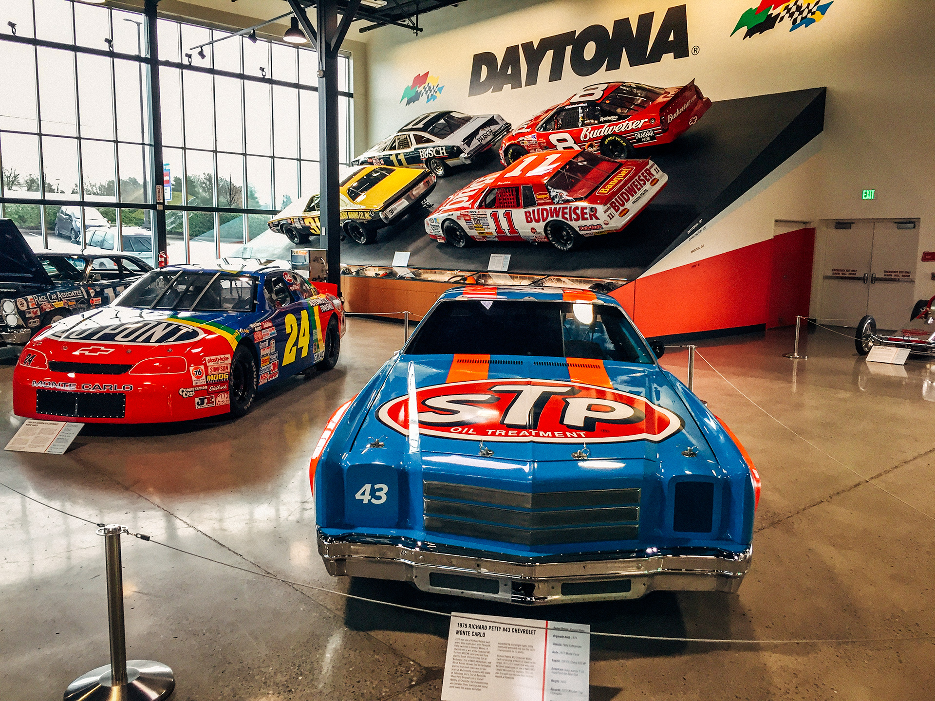 1979 Richard Petty #43 Chevrolet Monte Carlo with a life size replica of the 31-degree Daytona banking complete with four real NASCARs behind it at the World of Speed Museum
