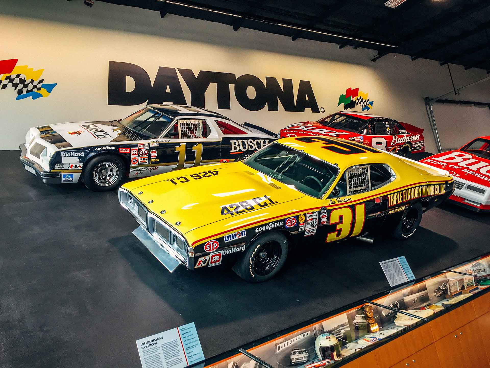 life size replica of the 31-degree Daytona banking complete with four real NASCARs behind it at the World of Speed Museum