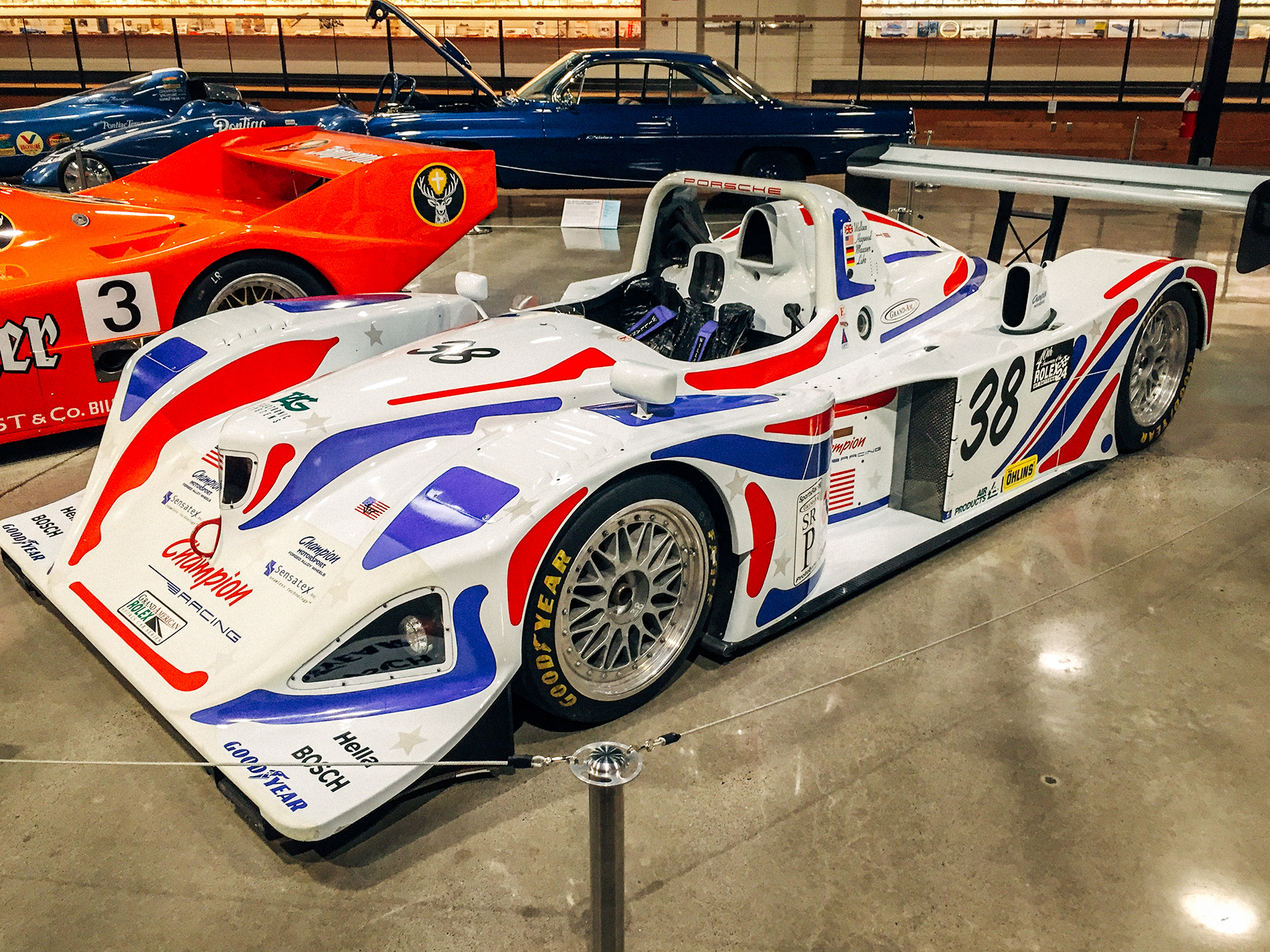 white, blue, and red champion racing race car at the World of Speed Museum