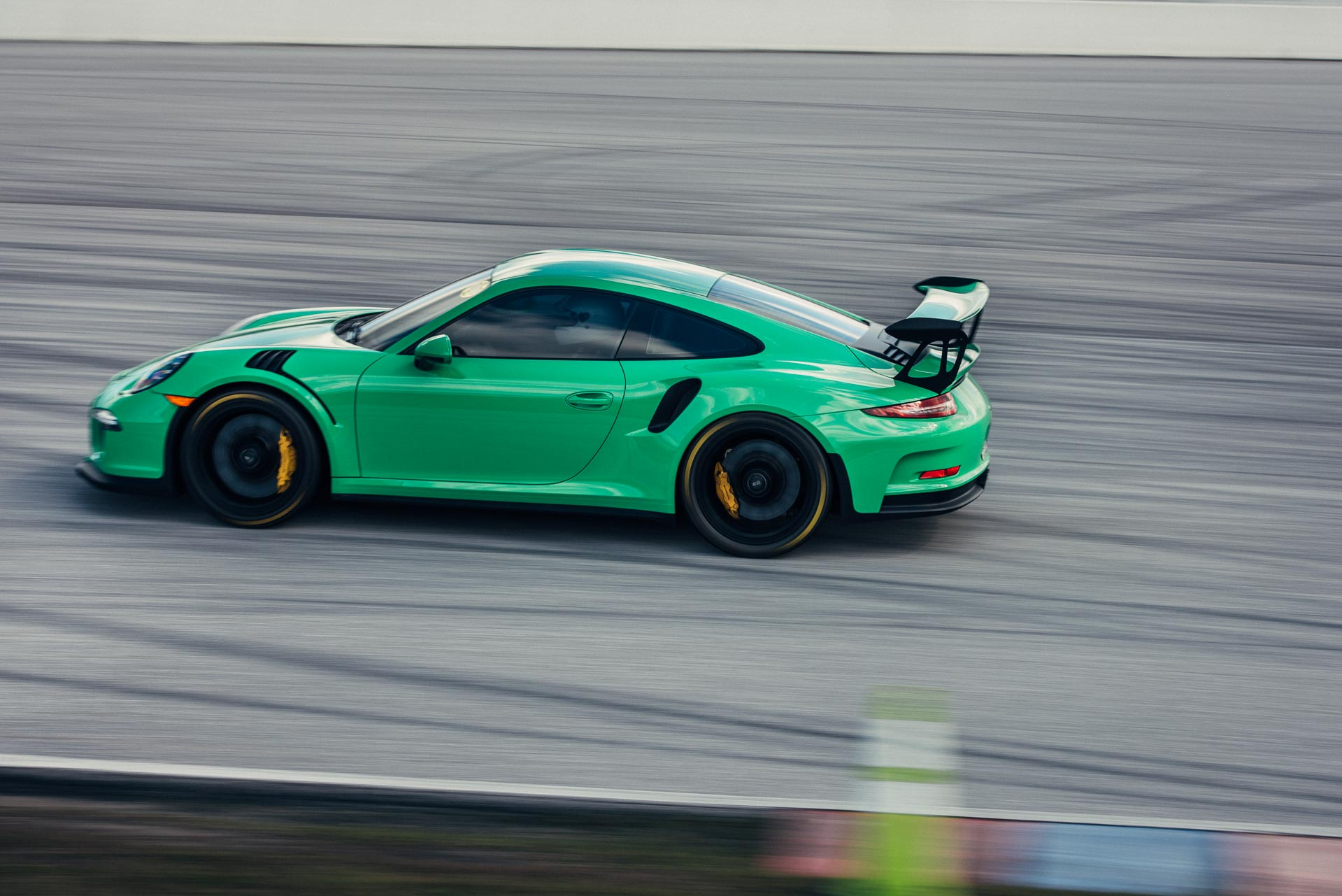 Green Porsche on track at DRT