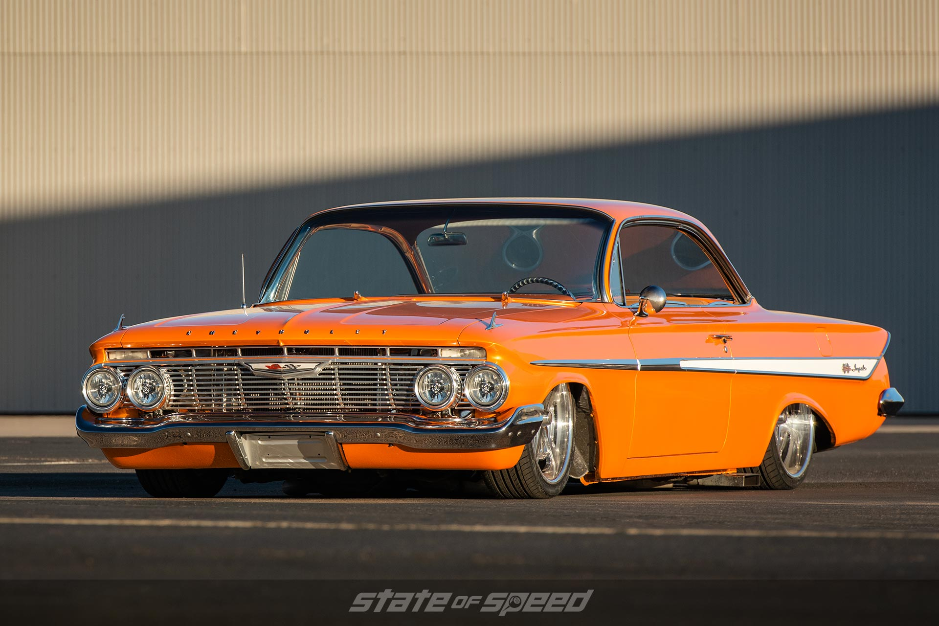 Orange 1958 chevy impala