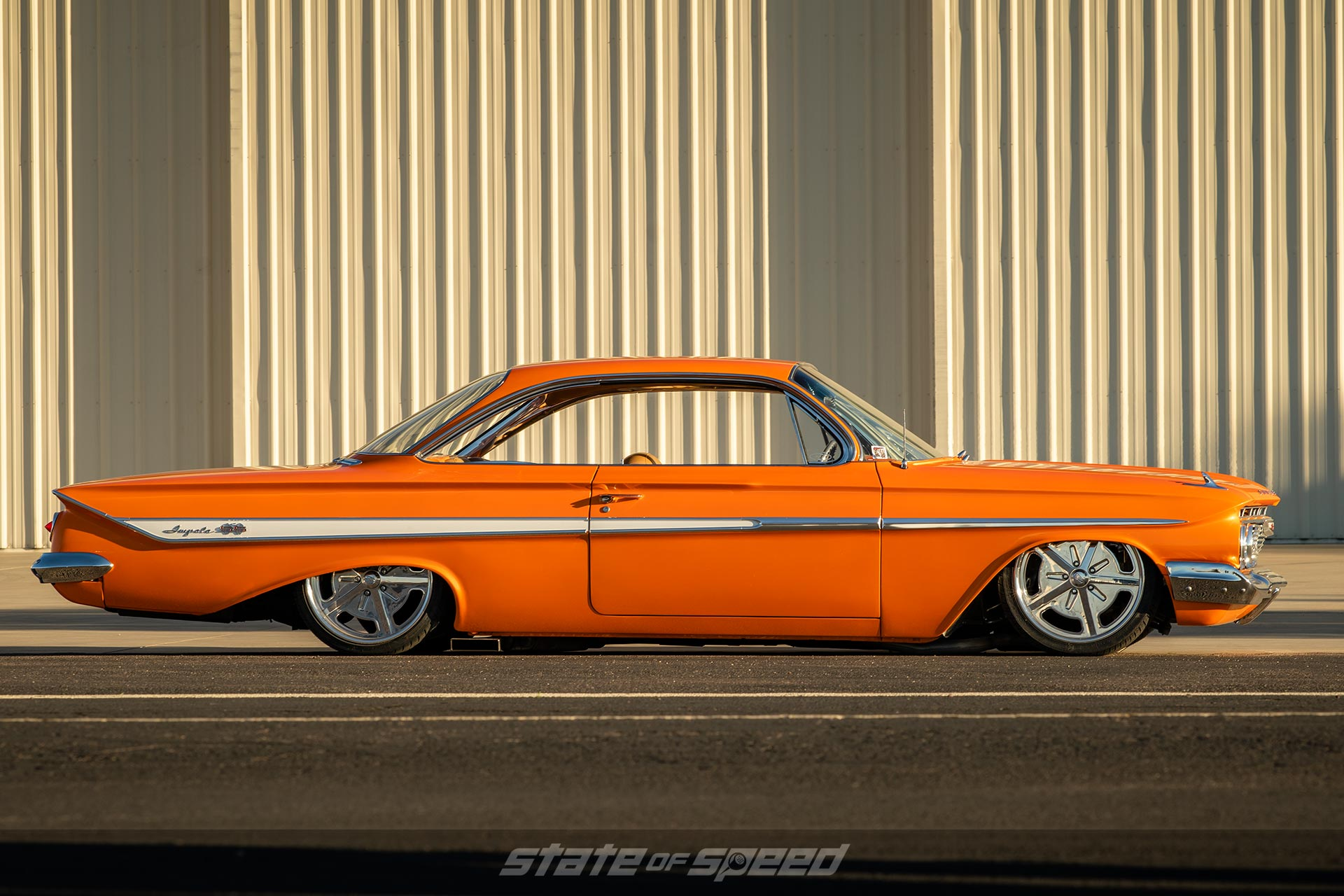 Orange Impala slammed and bagged