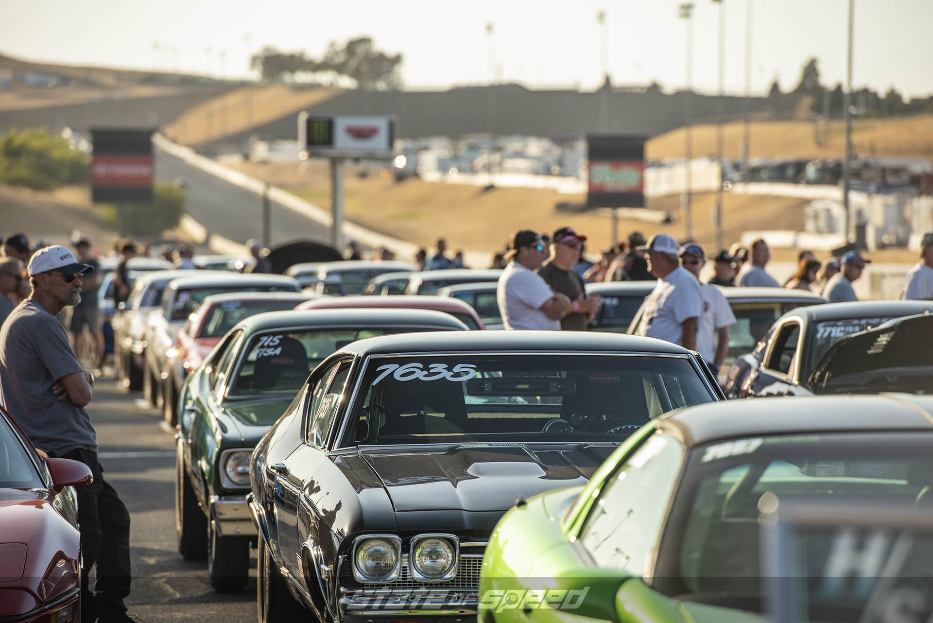 Lines of cars getting ready to race at the dragstrip