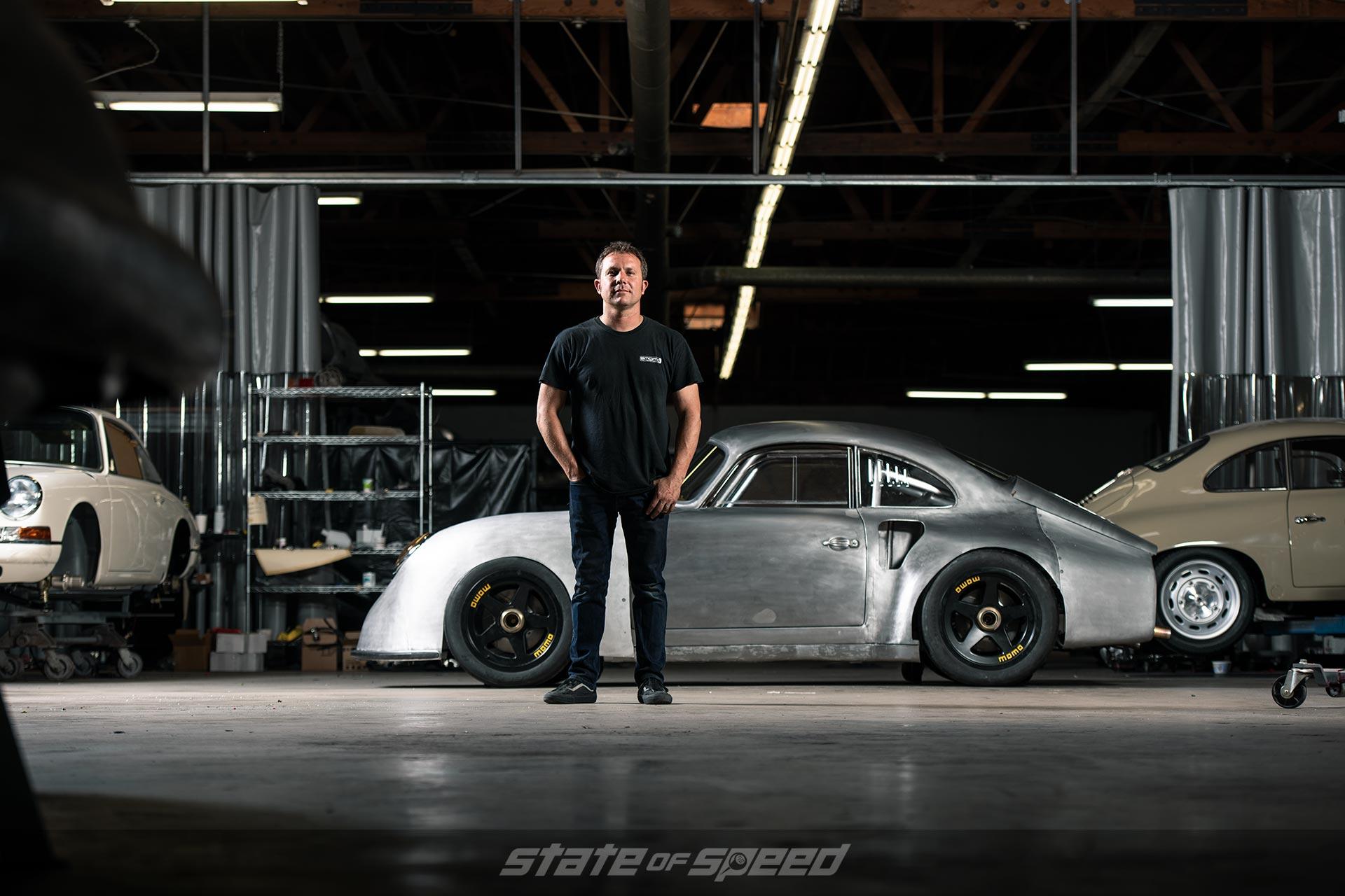 Rod Emory in front of a Cisneros' Porsche