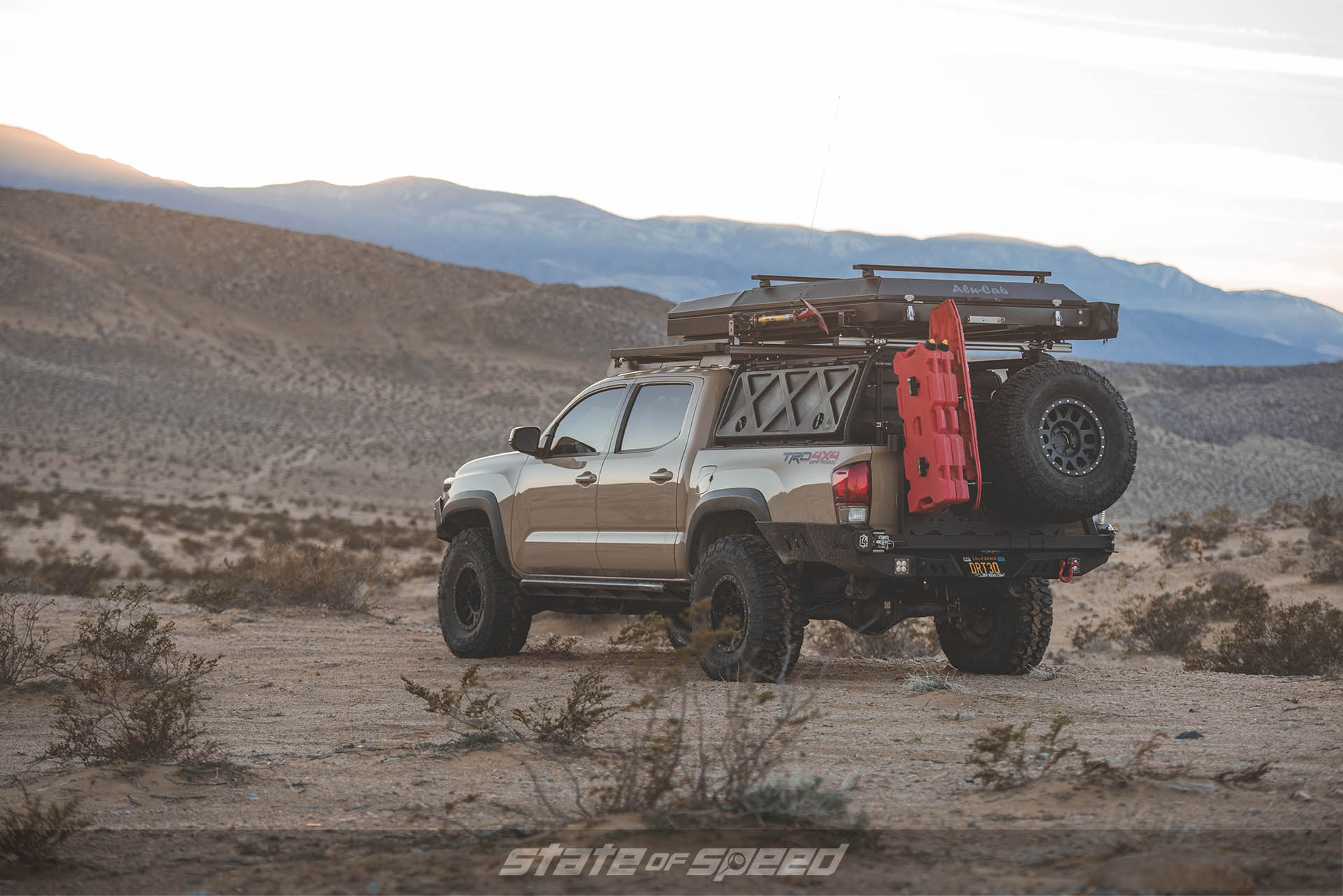 Tan Toyota Tacoma on Milestar Patagonia M/Ts with Off-Road Mods