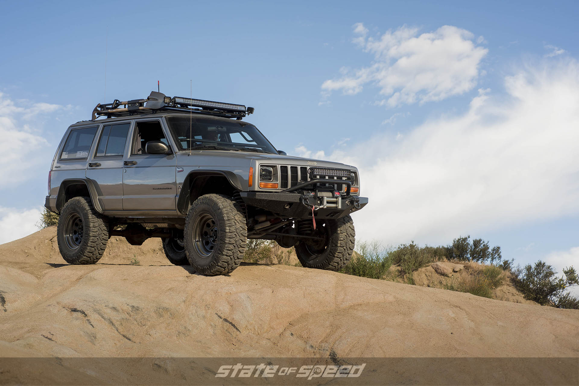 Modified Jeep XJ Cherokee sitting on Milestar Patagonia M/Ts with Off-Road Mods