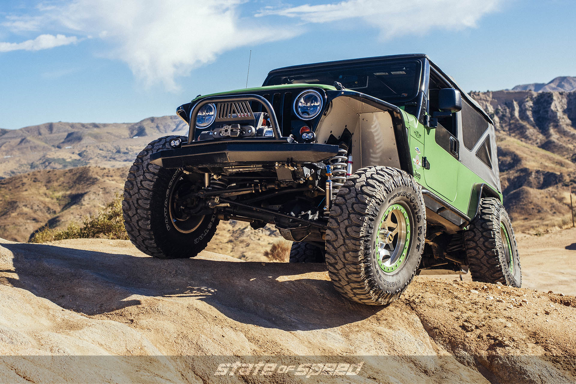 Green Jeep LJ Wrangler with Milestar Patagonia M/Ts on beadlock wheels