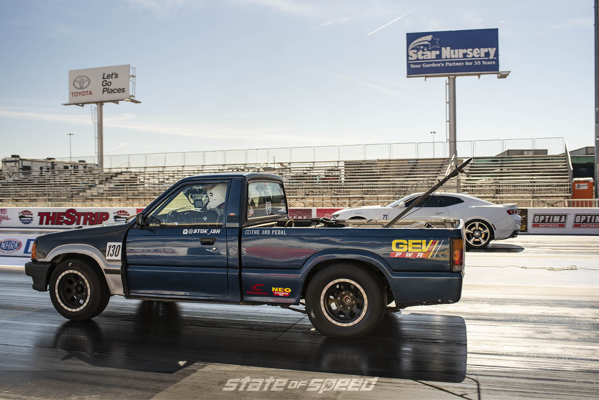 Truck versus Ford Mustang handicapped racing at the dragstrip