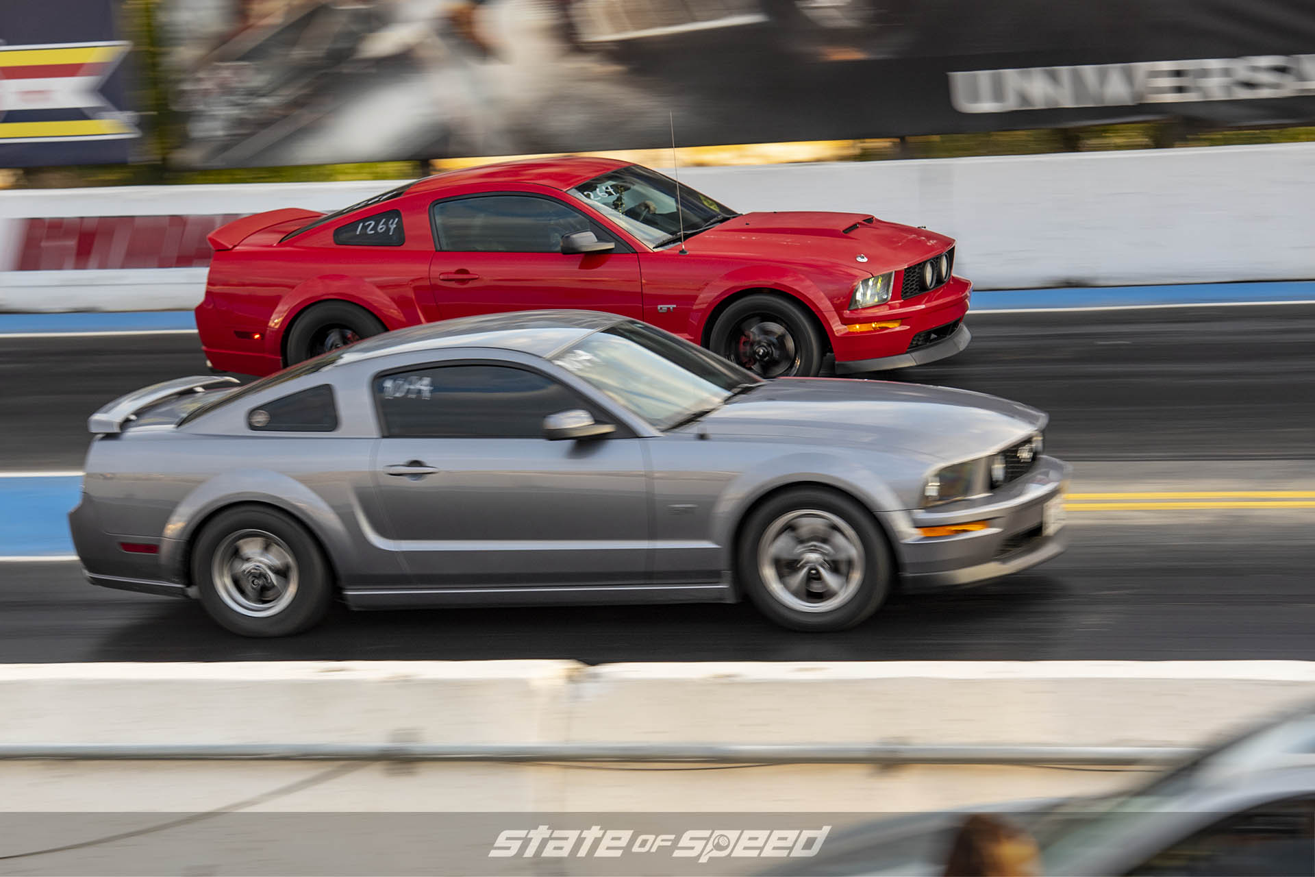 Ford Mustangs heads up racing on the dragstrip