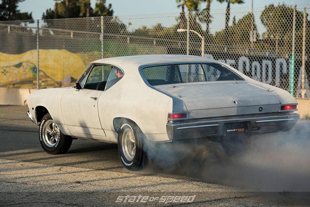 Gen 2 Chevy Chevelle muscle car doing a burnout
