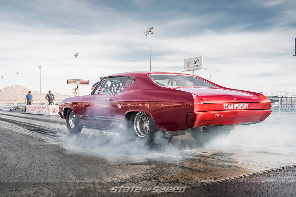 Chevelle muscle car doing a burnout at the drag strip