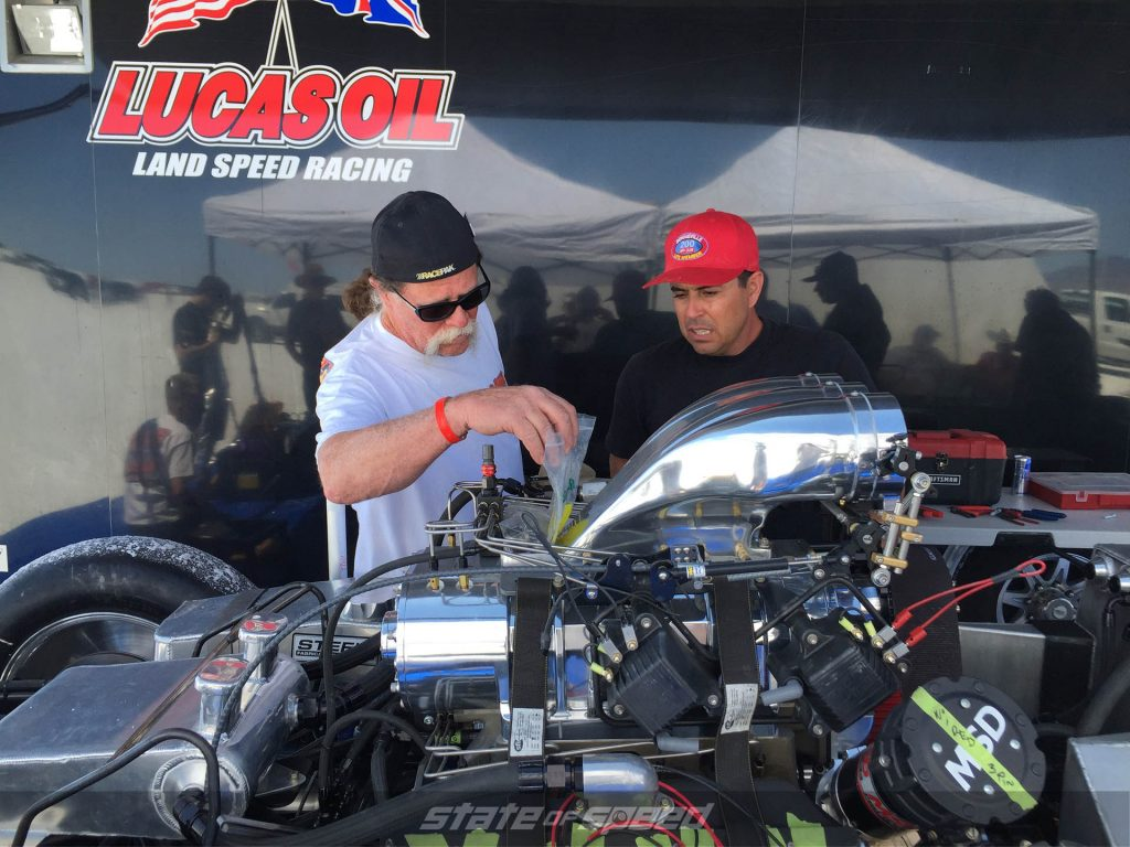 Racers tuning their engine at the raceway