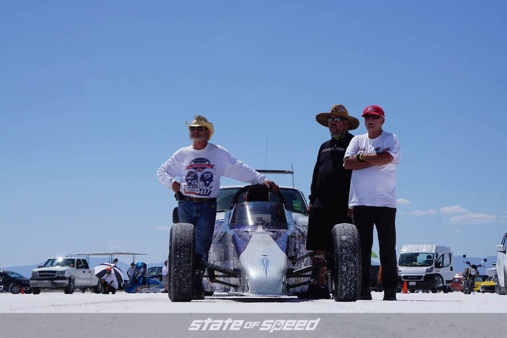 Race team next to their roadster