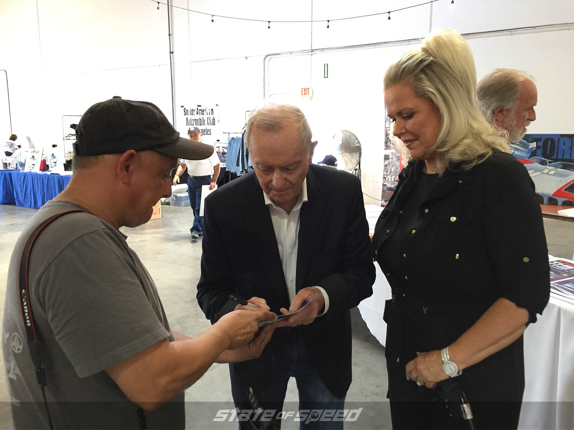 Bob Bondurant signing autographs at the Shelby headquarters