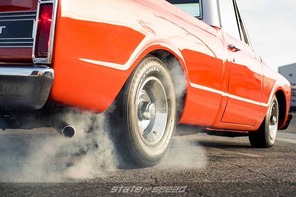Orange C10 doing a burnout