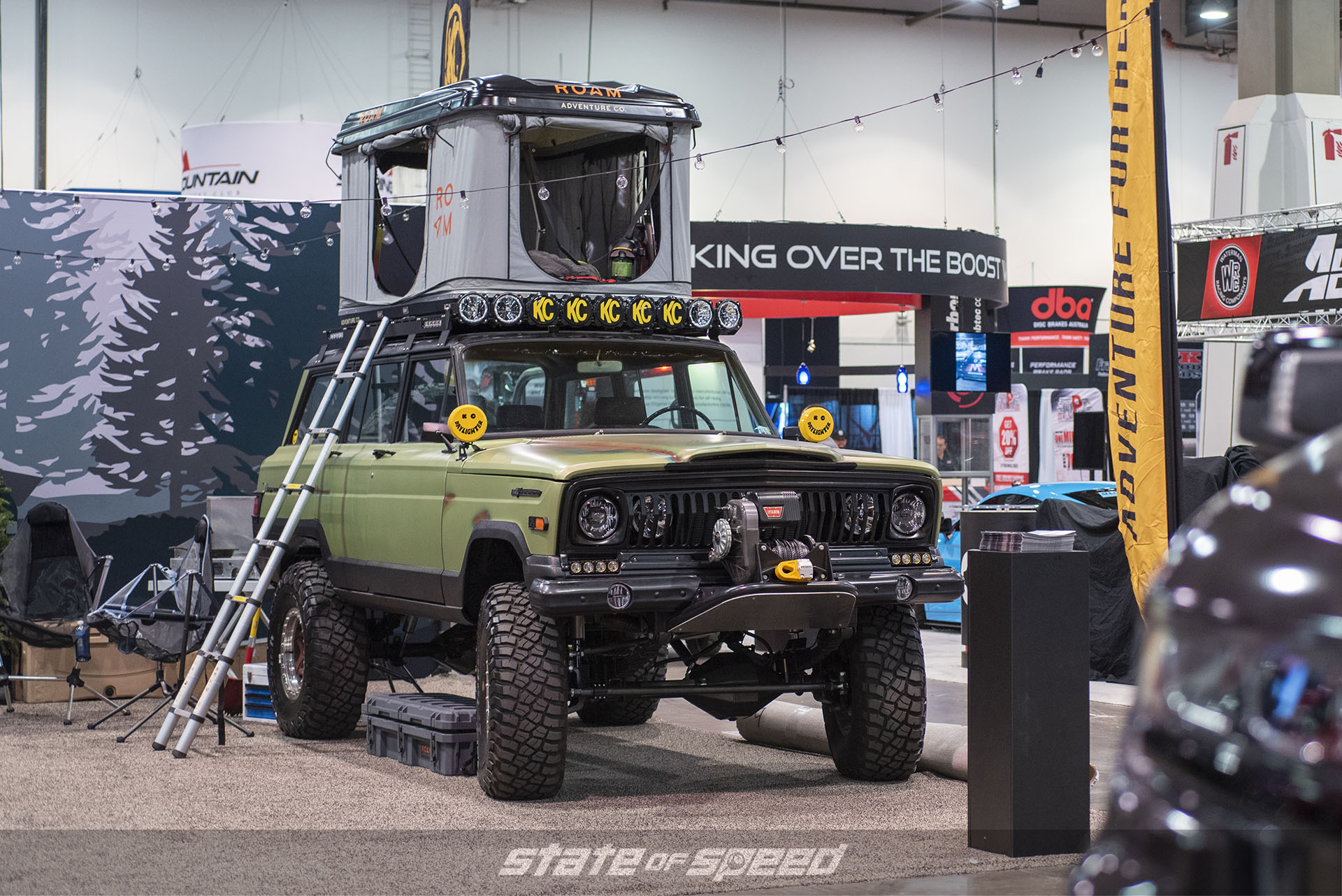 Overland Jeep Wagoneer at the KC Hilites booth at SEMA