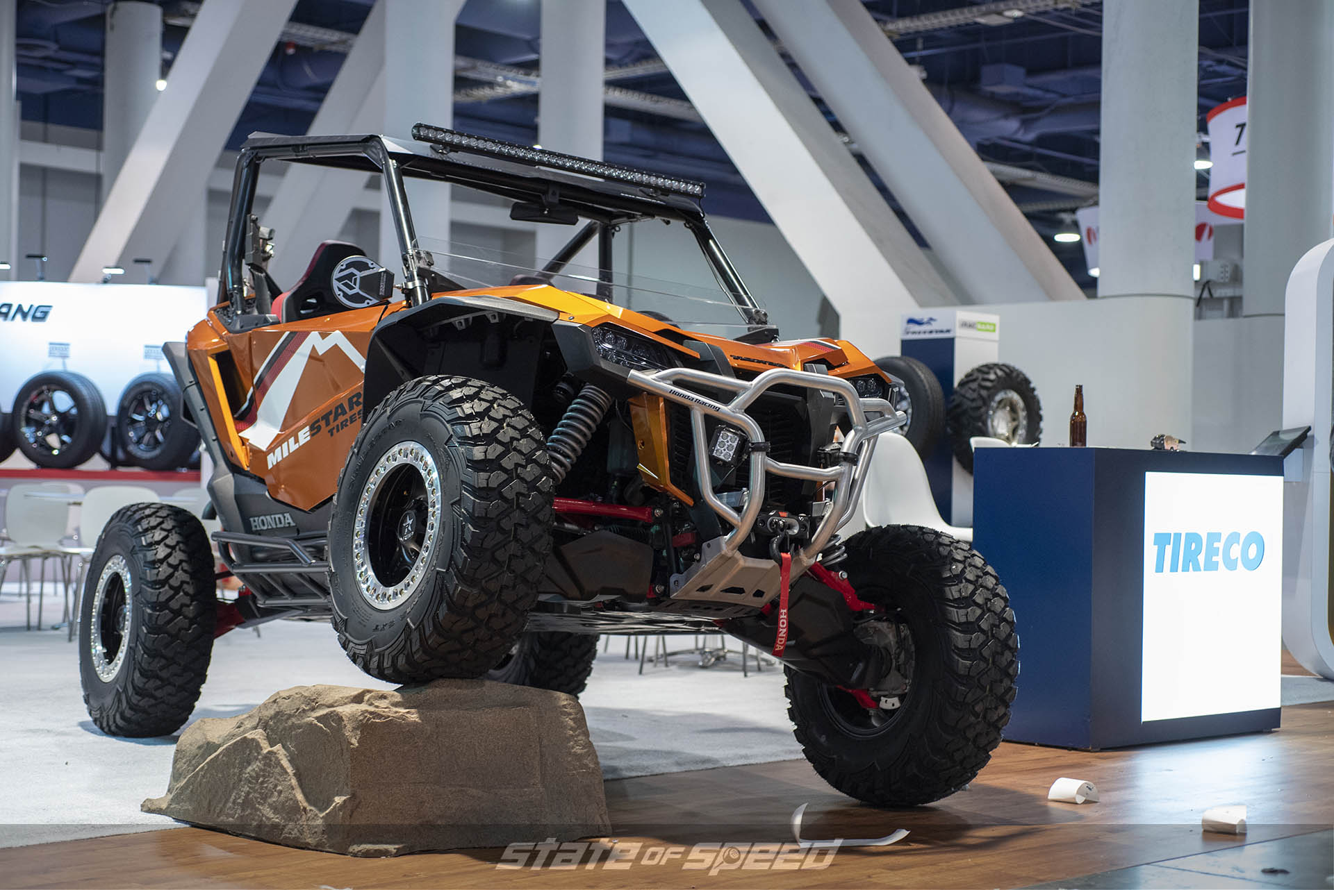 Milestar booth showing off the new SXT tire on a UTV at SEMA 2019