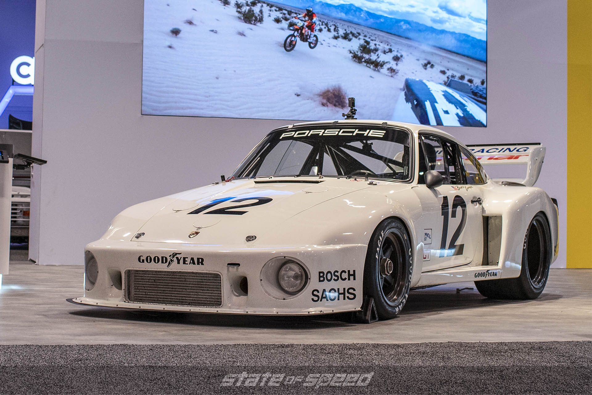 GoPro booth at SEMA displaying a race built Porsche