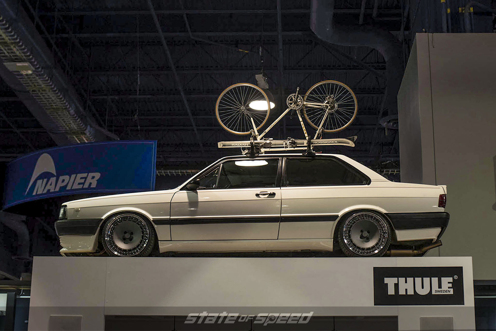 Thule booth with a slammed mercedes on display with a roof rack