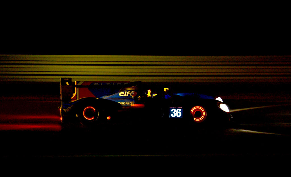Race car with glowing rotors