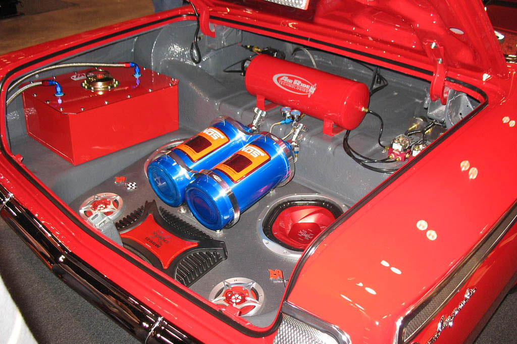 NOS nitrous system in trunk of red car