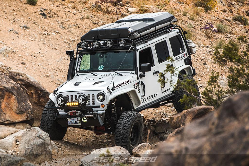 White overland style Jeep JK rock crawling