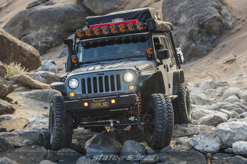 Overland jeep going over rocks