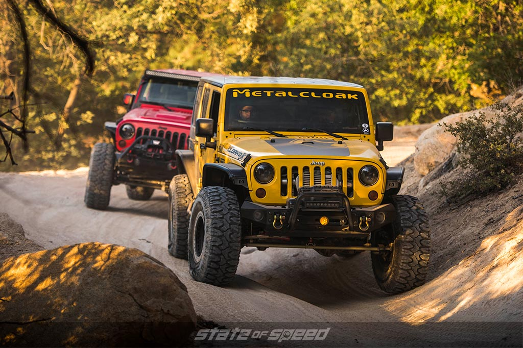 2 offroad vehicles on a trail