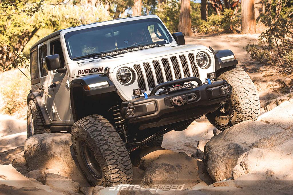 White Jeep JL crawling
