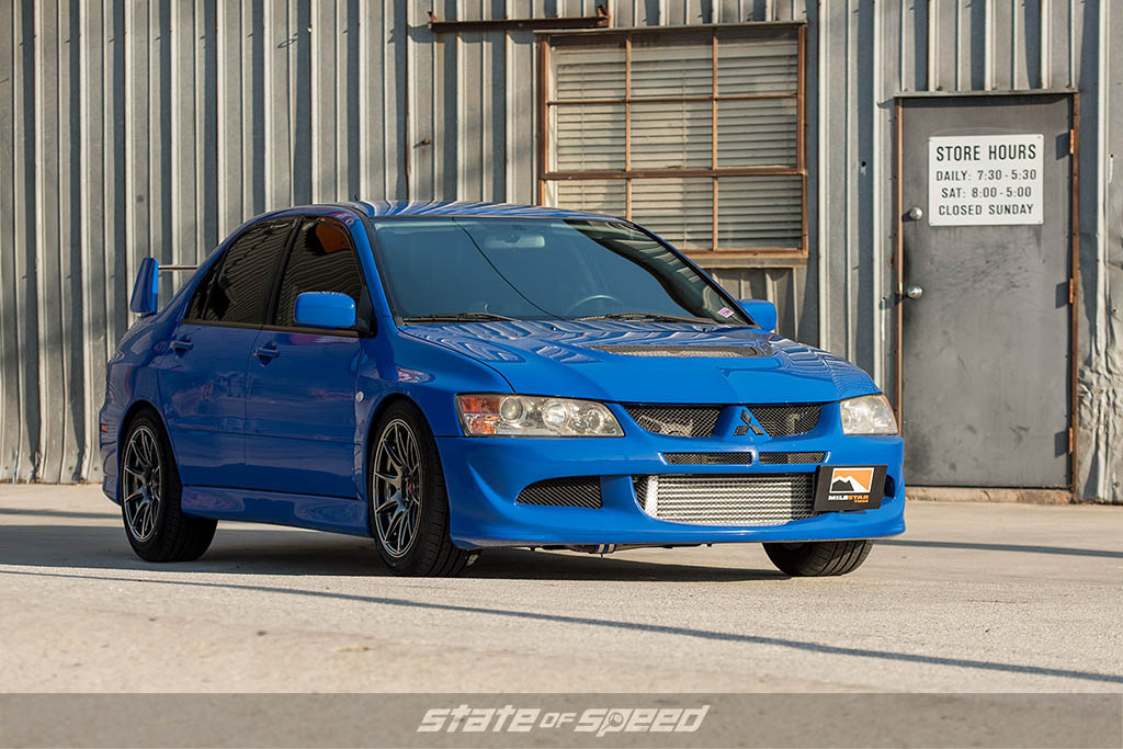 Blue Mitsubishi Lancer Evolution VIII on Milestar tires