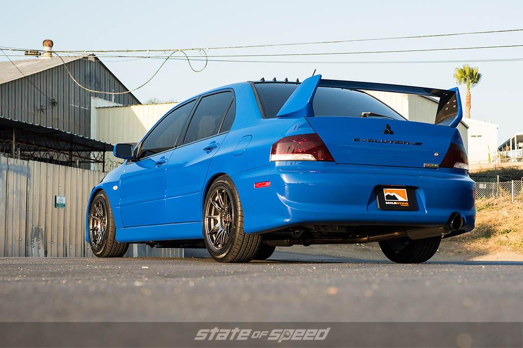 Blue Mitsubishi Lancer Evolution VIII on Milestar tires