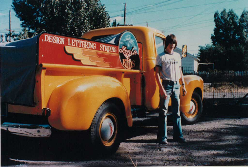Troy Lee in front of his father's business truck