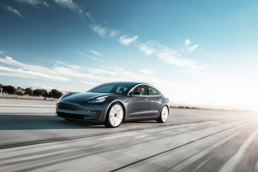 Silver Tesla electric car driving