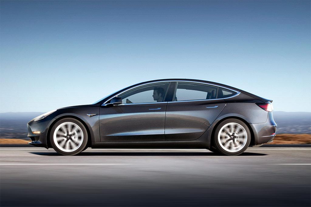 gray Tesla Model 3 electric car cruising