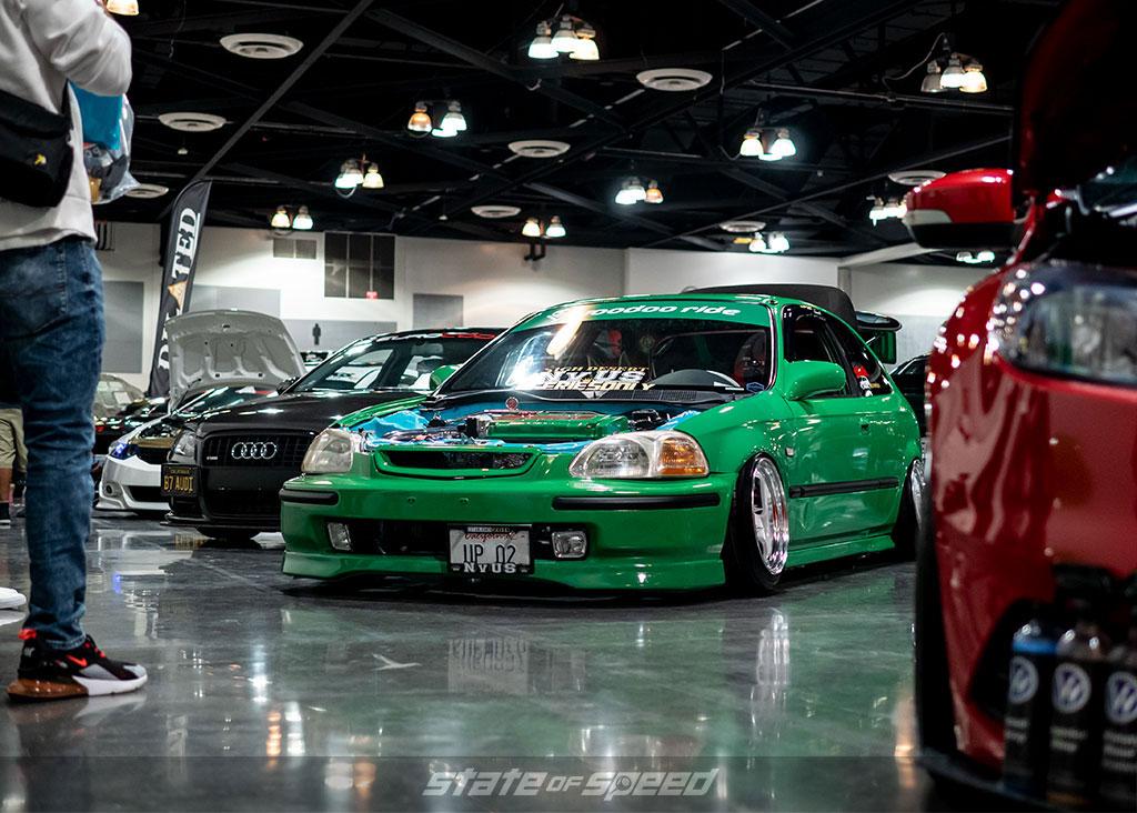 Green Honda Civic Hatchback EK9 with dressed up engine bay
