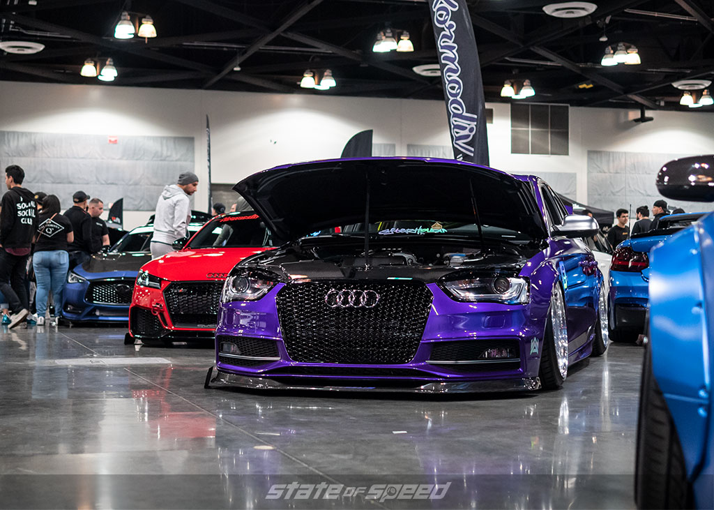 Purple Audi in a lineup of slammed cars at Slammedenuff Socal
