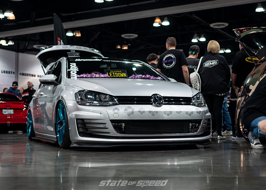 Hawaiian themed Bagged MK7 Volkswagen GTI on air bags at Slammedenuff