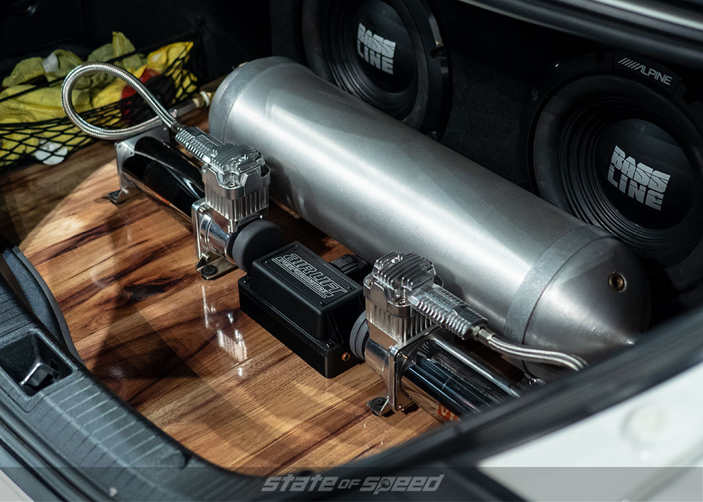 custom trunk setup and exhaust outlets on a mercedes
