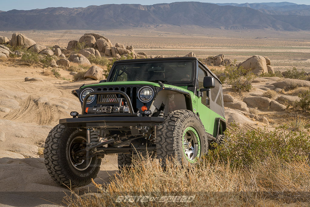 Green Jeep LJ crawling