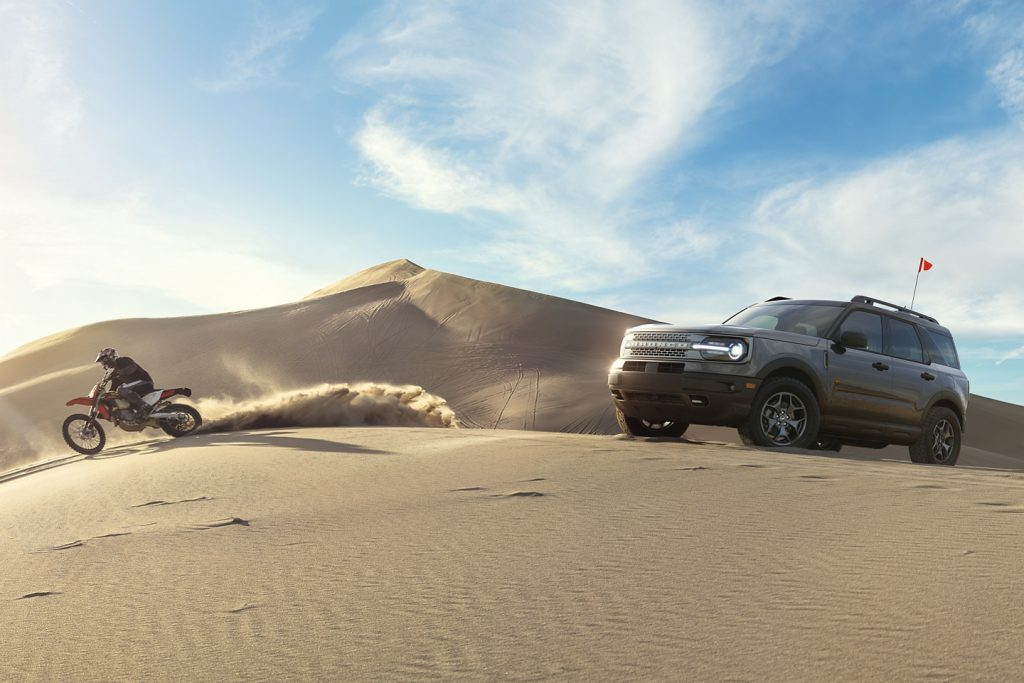 offroad suv in the sand dunes