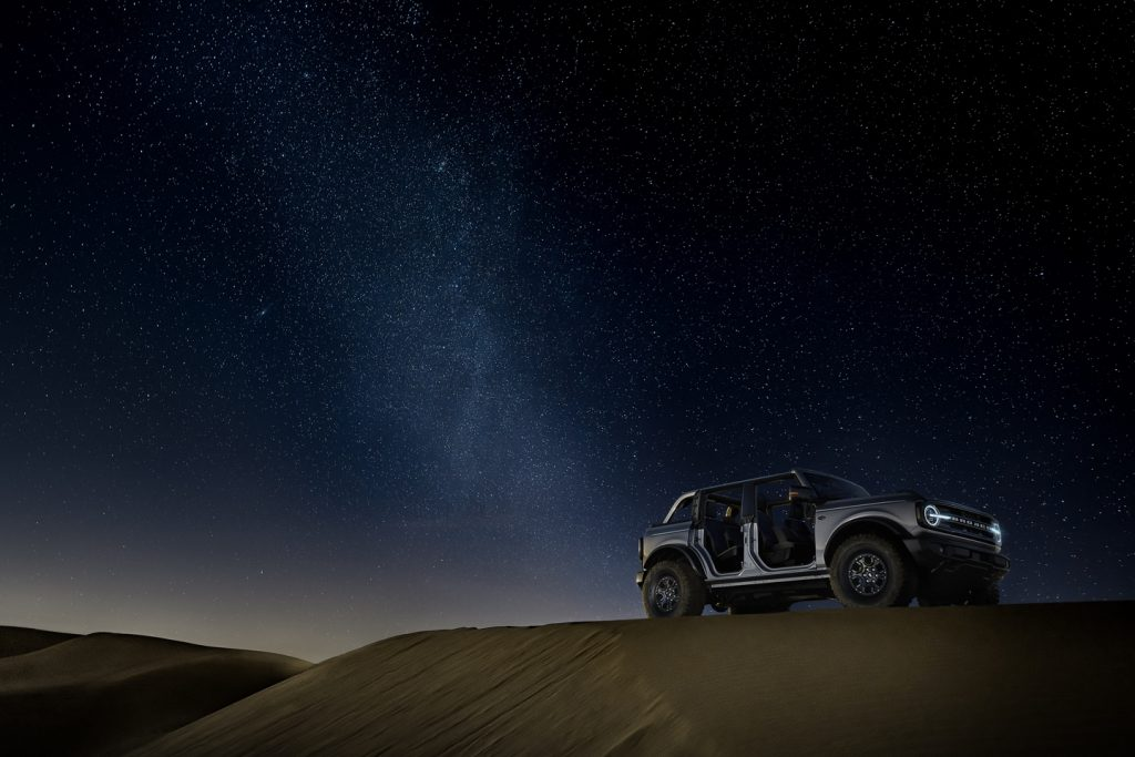 2021 offroad ford with removable doors in the desert under a night sky
